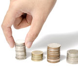 Hand putting stack of coins Royalty Free Stock Photography