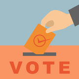 Hand putting a voting Royalty Free Stock Photos