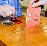 Hand putting a voting ballot in a slot of box Royalty Free Stock Photos