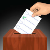Hand putting voting paper with approved checkmark in the ballot box Royalty Free Stock Images