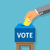 Hand putting voting paper in the ballot box Royalty Free Stock Photos