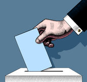 Hand putting voting paper in the ballot box. Vintage engraving s. Tylized colored drawing. There is in addition a vector format EPS 8 vector illustration