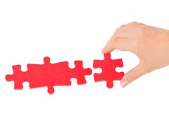 Hand and puzzle Stock Photography