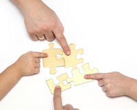 Hand with puzzle Stock Images