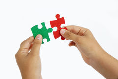 Hand and puzzle Stock Image