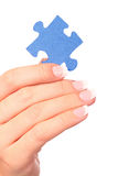 Hand and puzzle Royalty Free Stock Image