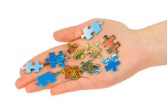 Hand and puzzle Royalty Free Stock Photography