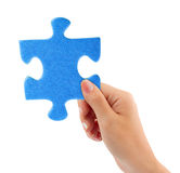 Hand with puzzle Stock Image