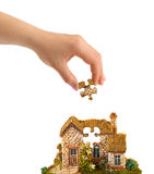 Hand and puzzle house Royalty Free Stock Photo