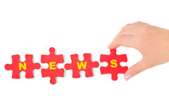 Hand and puzzle News. Isolated on white background stock photos