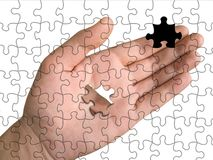 Hand from puzzle without one piece. (it layz on palm), white background Stock Image
