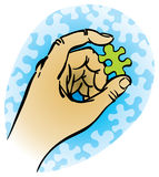 Hand with puzzle piece Royalty Free Stock Photography