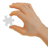 Hand with puzzle piece isolated with path Stock Photography