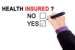 Hand with a question of health insured Stock Photos