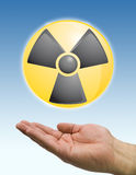 Hand and radioactive icon Royalty Free Stock Photos