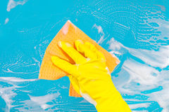 Hand with a rag cleans the surface Stock Image