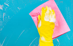 Hand with a rag cleans the surface. Cleaning concept, hand with a rag cleans the surface Stock Photo