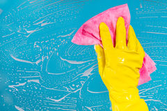Hand with a rag cleans the surface Stock Images
