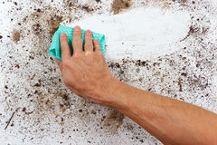 Hand with rag wiping dirty surface Stock Photos