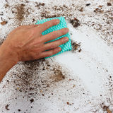 Hand with rag wiping heavily dirty surface Royalty Free Stock Photos