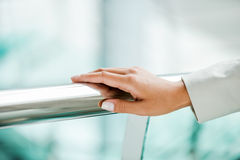 Hand on railing. Royalty Free Stock Images