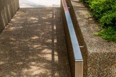 Hand on railing Stock Image