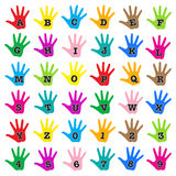 Hand rainbow alphabet. Vector colorful alphabet isolated over white background - black letters and numbers with white ouline inside colorful palms Royalty Free Stock Images