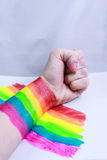 Hand and a rainbow in the fight Stock Photo