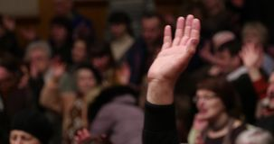 Hand Raised At Church Worship. Worship, Hand Raised At Church During In Congregation During Service. One hand raised at worship stock footage