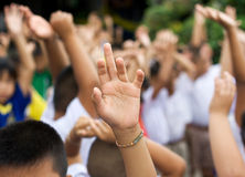 Hand raised in schoolyard Stock Photo