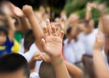Hand raised in schoolyard Stock Photos