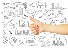 Hand with raised thumb and business sketches Stock Image