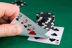 The hand raises a set of playing cards to see the alignment of the street, to increase the rate royalty free stock photography