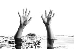 Hand raising above water Royalty Free Stock Photo