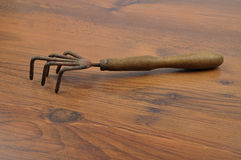 Hand rake on wood Stock Images