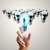 Hand Reach 3d Light Bulb Of Leadership Stock Photos