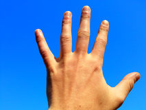 Hand reach for the beautiful clear sky Royalty Free Stock Images