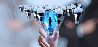 Hand reach 3d light bulb of leadership stock photos