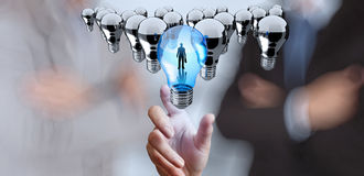 Hand reach 3d light bulb of leadership. Concept Stock Photos