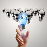 Hand reach  light bulb. Of leadership concept Stock Photos