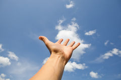 Hand reach for the sky. Hand reach for the blue sky Royalty Free Stock Image