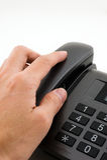 Hand reach for telephone Stock Photos
