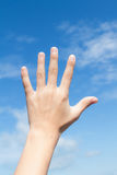 Hand reach to the blue  sky Royalty Free Stock Images