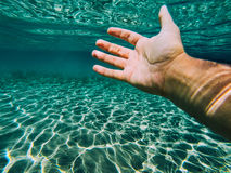 Hand reached. Male hand reached from underwater Stock Photo