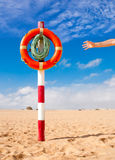 Hand reaches for Life Buoy Stock Photo