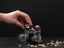 Hand reaching for chocolates. Concept of snacking. royalty free stock photography