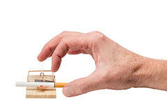 Hand Reaching for Cigarette in Mousetrap Royalty Free Stock Image