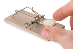 Hand Reaching Coin On Mousetrap Royalty Free Stock Photography