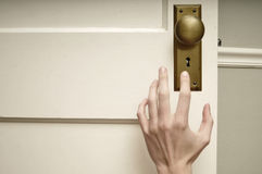 Hand reaching for doorknob Stock Image