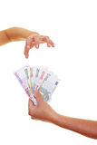 Hand reaching for Euro banknotes Stock Photography